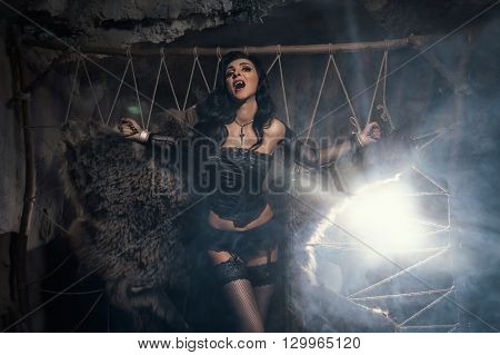Gothic style Vampire woman. Beautiful Glamour Fashion Sexy Vampire Lady Halloween portrait.