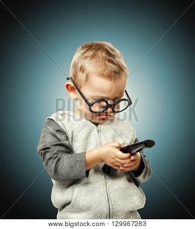 little child with remote control