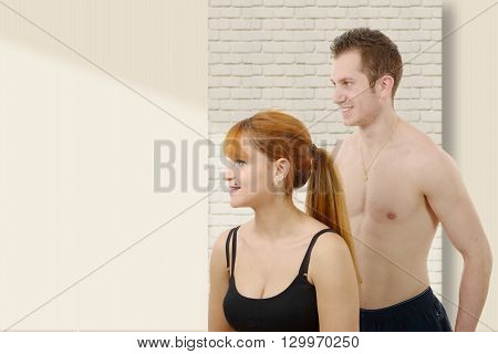 Beautiful young woman and man doing stretching exercises