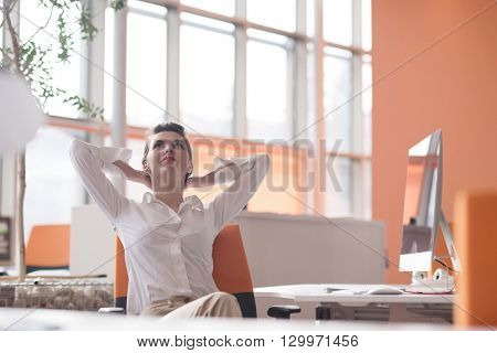 happy young business woman relaxing and geting insiration while working on desktop computer at modern bright  starup office interior