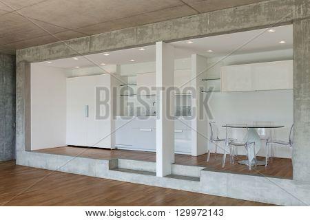 Interior, modern kitchen of concrete apartment, parquet floor