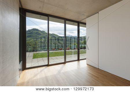 Architecture, room of modern building, windows overlooking the garden