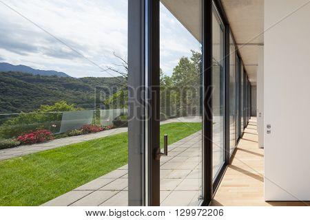 Architecture, corridor of modern building, windows overlooking the garden