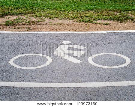 Close Up of Bike Lane Sign Beside Road