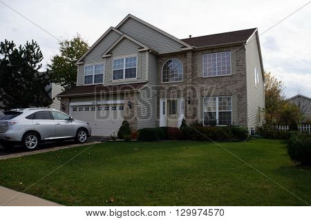 JOLIET, ILLINOIS / UNITED STATES - NOVEMBER 5, 2015: A tract home in the Wesmere Country Club neighborhood of Joliet.