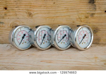 Pressure gauge of oil and gas industry on wooden background, Equipment of production process