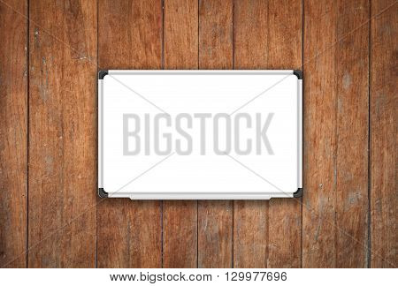 Blank white board on old wooden texture background, stock photo