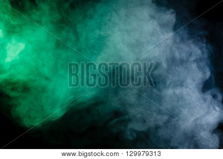 Abstract art. Blue-green smoke hookah on a black background. Inhalation. The steam generator. The concept of poison gas. Gas.