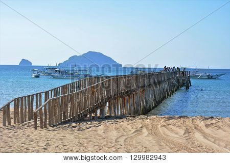 EL NIDO PALAWAN PHILIPPINES - APRIL 5 2016: Wooden boat dock at the El Nido airport. Travelers leave the airport and board boats to other island destinations.El Nido Boat Dock