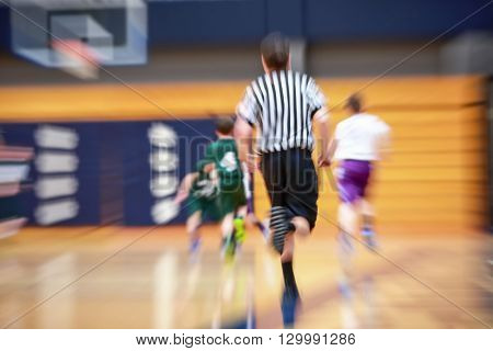 Youth basketball motion blurred background