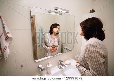 Beauty And Health Concept. Picture Of Attractive Brunette Asian Senior Woman Wearing Pajamas, Lookin