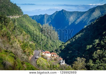 Ribeiro Frio village between the mountains of Madeira, view from popular hiking route Balcoes levada. Madeira island, Portugal.