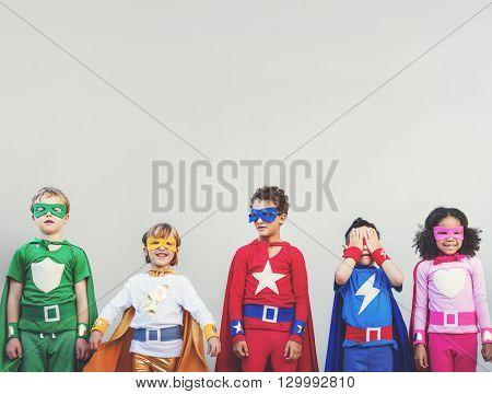 Superhero Kids Aspiration Imagination Playful Fun Concept poster