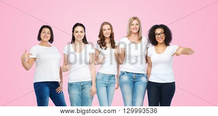 friendship, diverse, body positive and people concept - group of happy different size women in white t-shirts pointing finger to themselves over pink background