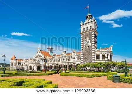 Dunedin New Zealand - November 16 2014: Dunedin railway station on a sunny day built 1906 in a revived Flemish renaissance style Otago Region New Zealand.