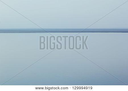 Light blue minimalist landscape with a horizon line. Copy space. Background.