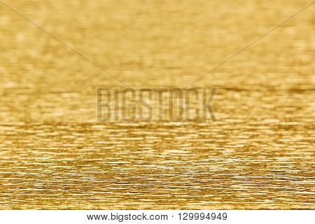 Abstract gold background with blur. The texture.
