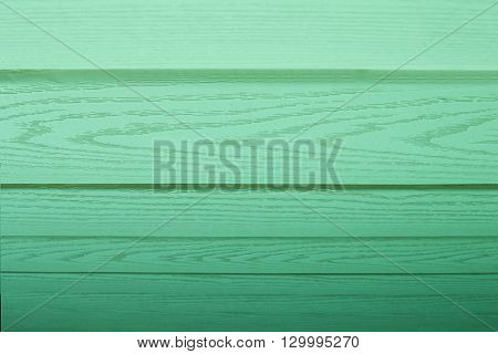 Green wooden background. Mint color background. Horizontal boards. Wood texture.