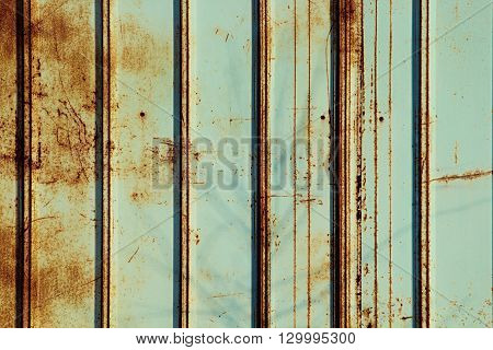 Rusty fence mint color. Mint color background. Rusty metal panel.