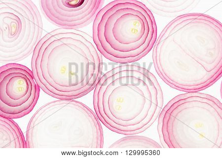 Sliced pink onion. Slices. Pattern. Macro. Texture. Food background.