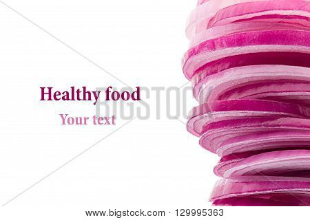 Pyramid from slices of pink onion. Frame with copy space. Concept art. Pattern. Food background.