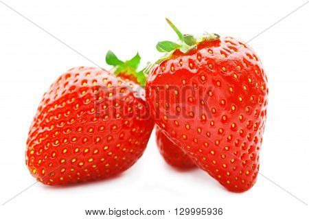Three strawberries isolated on a white background