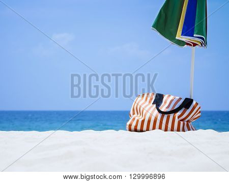Bag and Umbrella on Sand Beach Summer Holiday Travel Outdoor