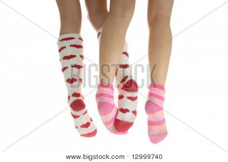 Four crossed legs with colorful socks (isolated on white) - friendship or love concept poster