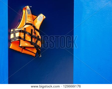 Life vest on blue wall background, Safety guard Equipment Rescue