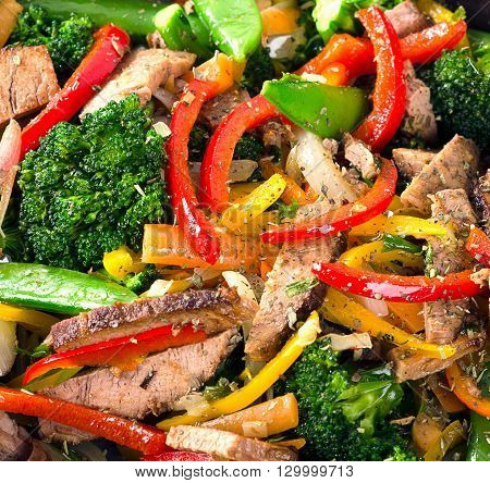 Beef Vegetables Stir Fry On A Wooden Table.