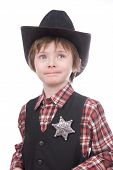 young sheriff boy wearing a marshals badge and a cowboy hat isolated over white poster