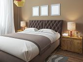 Luxury large modern double bed in the bedroom loft style. Bed linen in white and brown colors. Above the bed three mockup. On the sides are two bedside tables with lamps. 3D render. poster