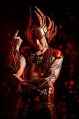 Fire steampunk man with a mechanical devices. Fantasy. Hephaestus. poster