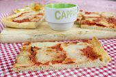 handcraft margherita pizza with near a cup of cappuccino poster