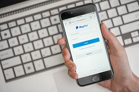 Melbourne, Australia - May 10, 2016: Using PayPal on iPhone. PayPal is a worldwide online payment system and one of the most popular ways of making payment on the Internet.