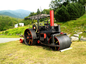 OLD ROLLER, CONSTRUCTION ROLLER AT BASE OF MOUNTAIN