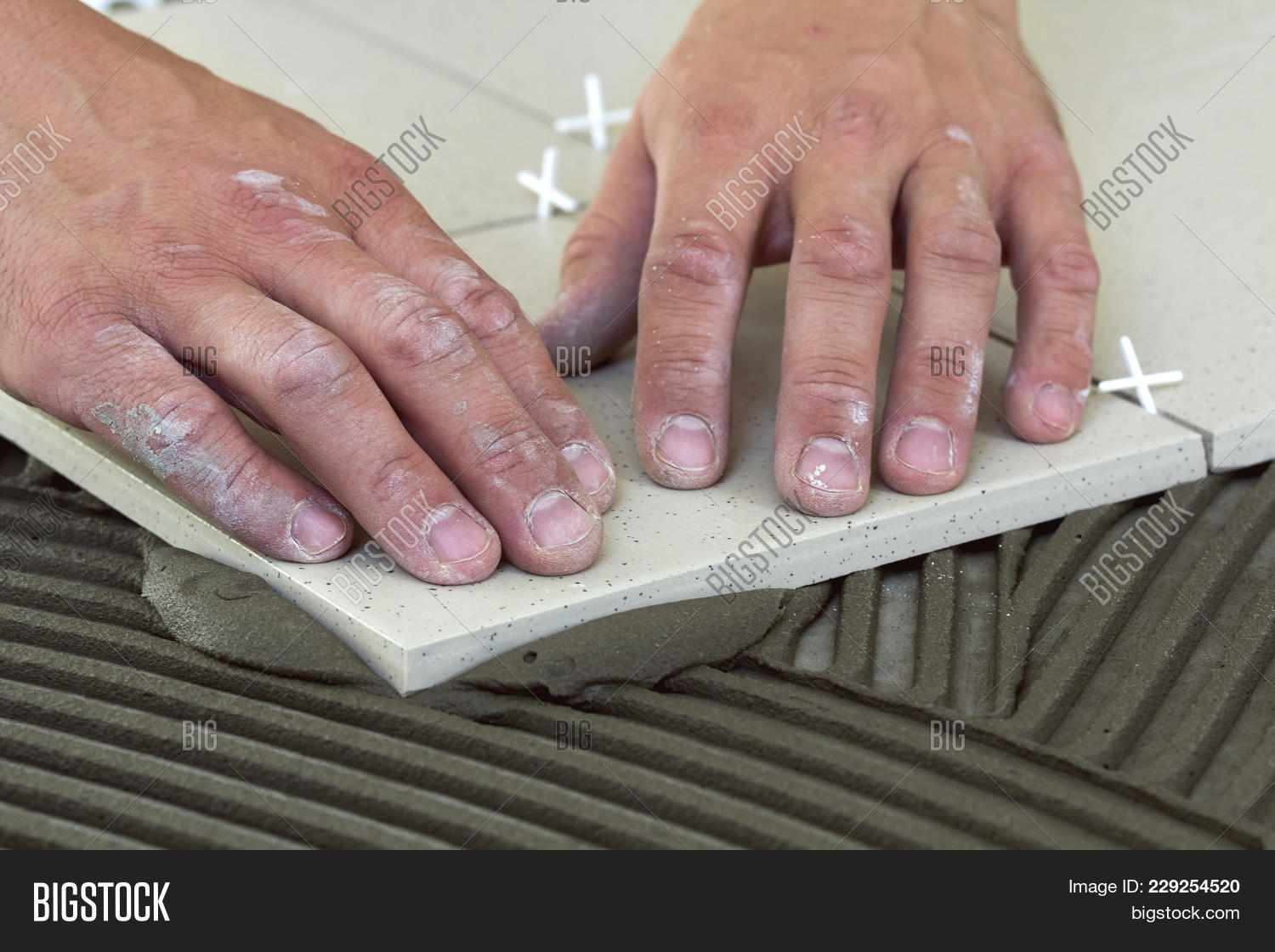 Workers hands ceramic tiles tools image photo bigstock workers hands with ceramic tiles and tools for tiler floor tiles installation home improvement dailygadgetfo Image collections