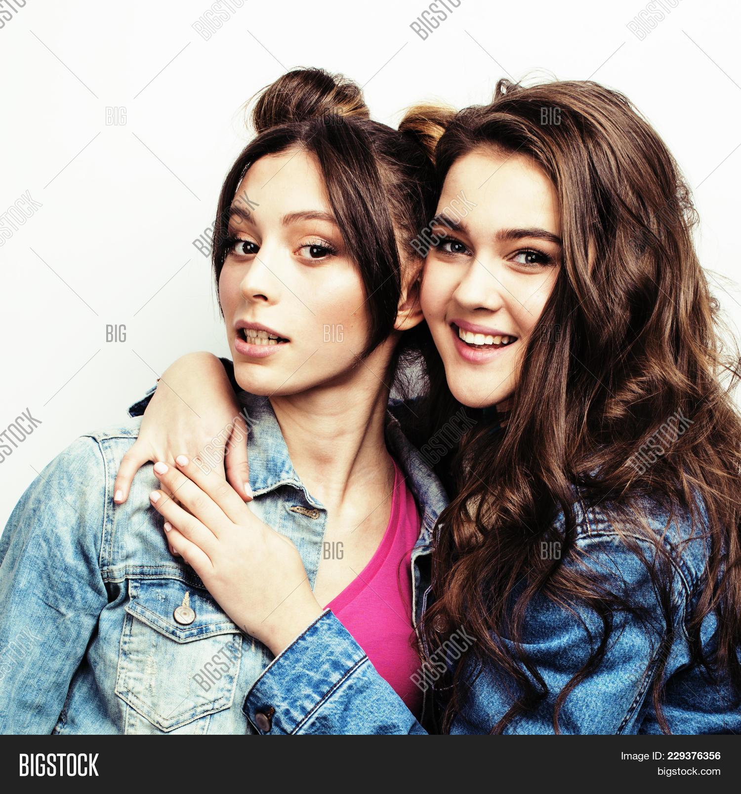 Two Best Friends Teenage Girls Together Having Fun Posing Emotional On White Background Besties