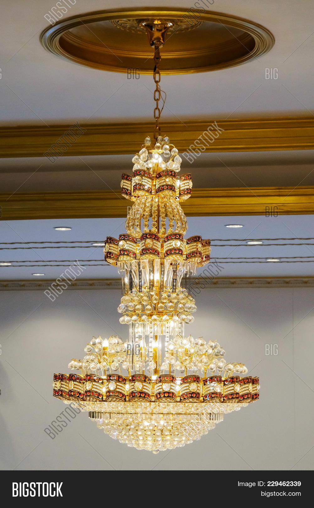 Elegant crystal chandelier on image photo bigstock elegant crystal chandelier on the background antique arubaitofo Choice Image
