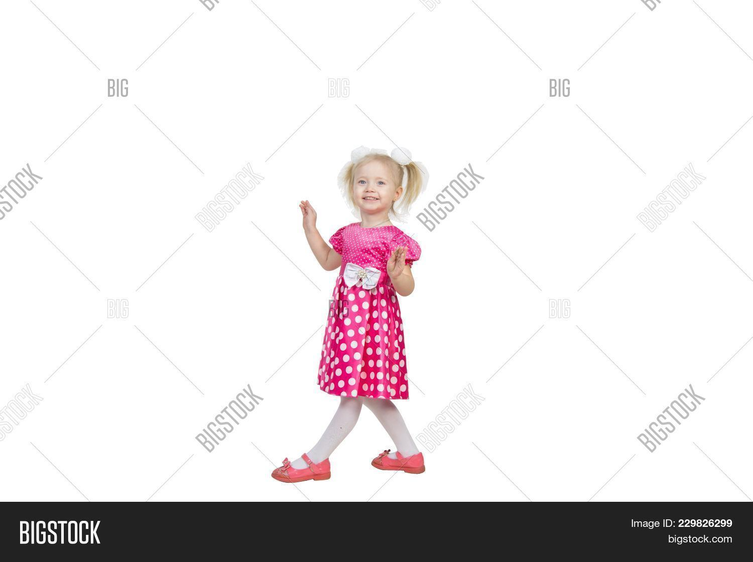 ea449d7e31 Girl 3 years old in a red dress on a transparent background PNG file. Beautiful  little girl in a bright pink dress with bows in her hair