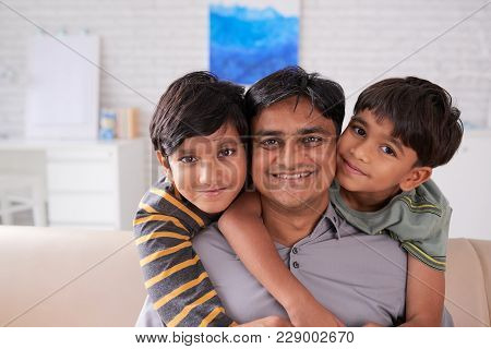 Portrait Of Cheerful Father And His Two Sons