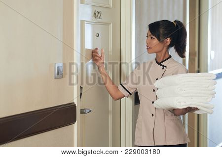Pretty Maid Knocking On Door To Change Towels In Room