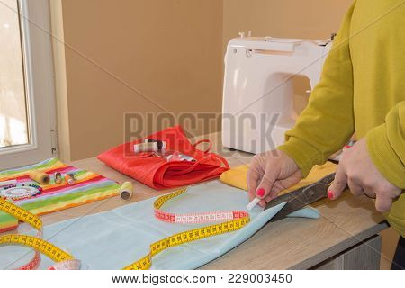 Sewing Machine.sewing Process In The Phase Of Overstitching. Dressmaker Work On The Sewing Machine.