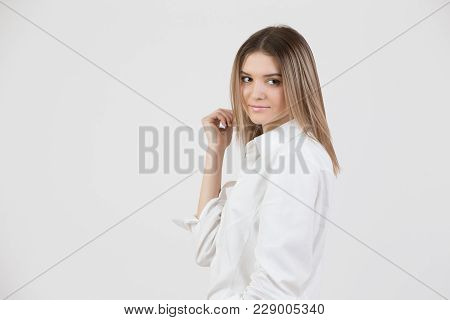 Beautiful Young Woman With A Gentle Face And Intelligent Look