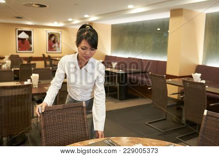 Banquet Manager Checking If Everything Is Ready For Occasion