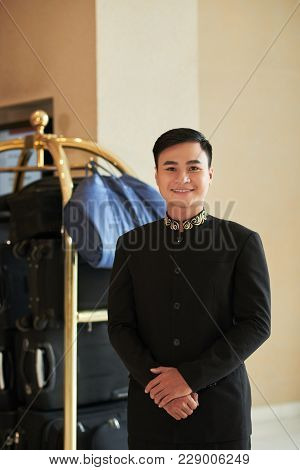Portrait Of Cheerful Hospitable Vietnamese Hotel Servant