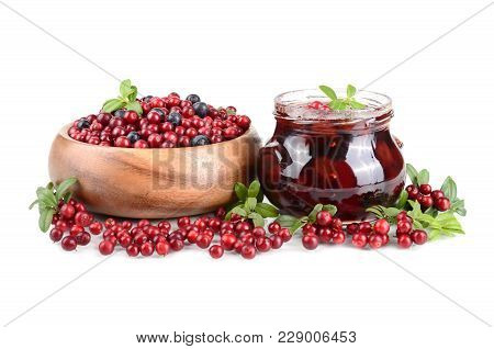 Cowberry Jelly And Fresh Berrys In A Round Wooden Bowl On White Background