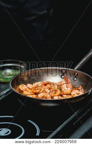 Shrimp On Frying Pan. Thermal Processing Of Food. Electric Cooker In A Restaurant. The Chef Is Going