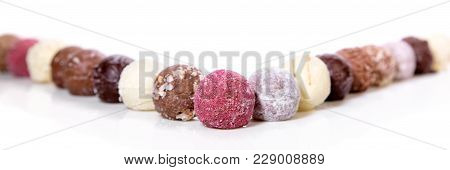 Variation Of Gourmet Chocolate Truffles Or Pralines On White Background, Header
