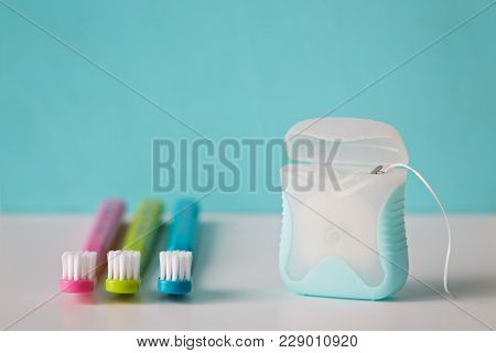 Dental hygiene. Dental floss with toothbrush.